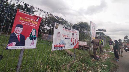Masa Tenang, Tim Gabungan Tertibkan APK Pilkada Depok